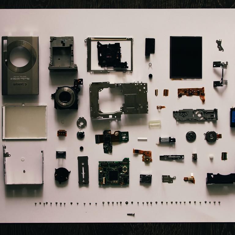 Bestandteile der Nahrungsmittel - Einzelteile einer zerlegten Digitalkamera